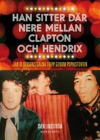 Han sitter där nere mellan Clapton och Hendrix